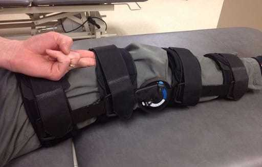 Putting the brace on your leg
